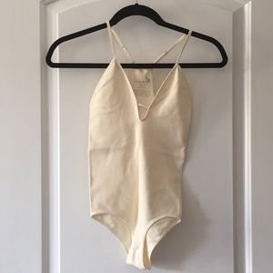 Only worn once eggshell free people bodysuit